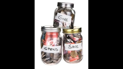 """Teach your children to be giving by helping them save for charity. Have them put aside their allowance money for """"spend,"""" """"save"""" and """"gift"""" allowance jars. The child decides where the proceeds in the """"give"""" jar go."""