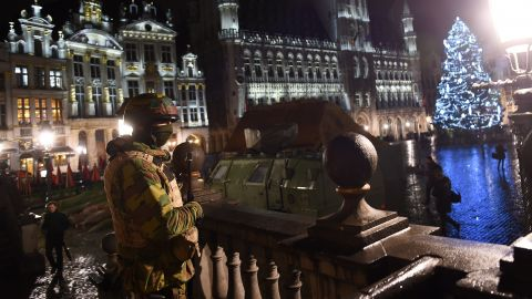 """A Belgian soldier stands guard around a security perimeter as a reported police intervention takes place around the Grand Place central square in Brussels on November 22, 2015. Brussels will remain at the highest possible alert level with schools and metros closed over a """"serious and imminent"""" security threat in the wake of the Paris attacks, the Belgian prime minister said. AFP PHOTO / EMMANUEL DUNAND        (Photo credit should read EMMANUEL DUNAND/AFP/Getty Images)"""