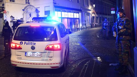 Belgian police officers and soldiers secure an area as a reported police intervention takes place around the Grand Place central square in Brussels on November 22.