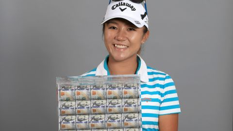 Lydia Ko poses with a box of $1 million in cash -- her prize for winning the Race to the CME Globe. The teenager also scooped the LPGA Player of the Year award to cap off an outstanding weekend.