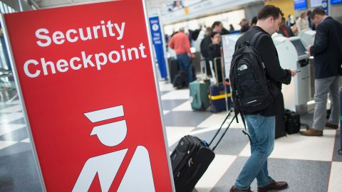 A sign directs travelers to a security checkpoint staffed by Transportation Security Administration workers at O'Hare Airport in Chicago on June 2, 2015.