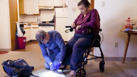 Withers and his group have reached more than 10,000 individuals and helped more than 1,200 of them transition into housing. Withers met Lois -- pictured here, receiving a home visit -- when she was living on the streets.