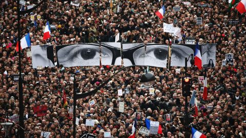 """<strong>January 11:</strong> The eyes of Charlie Hebdo editor Stephane Charbonnier appear at <a href=""""http://www.cnn.com/2015/01/11/world/gallery/paris-unity-rally/index.html"""" target=""""_blank"""">an anti-terrorism rally in Paris.</a> More than a million people took part in the demonstration, a gesture of unity just days after Charbonnier and 16 others were slaughtered."""