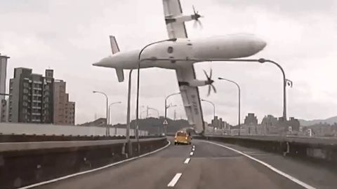 """<strong>February 4:</strong> In this still image taken from video, <a href=""""http://www.cnn.com/2015/02/04/asia/gallery/taiwan-transasia-plane-crash/index.html"""" target=""""_blank"""">TransAsia Airways Flight GE235</a> clips a bridge in Taipei, Taiwan, shortly after takeoff. The twin-engine turboprop airplane then plunged into the Keelung River. There were only 15 survivors among the 58 people on board. Pilots <a href=""""http://www.cnn.com/2015/02/07/asia/taiwan-transasia-plane-crash/"""" target=""""_blank"""">had grappled with engine problems</a> before the crash, Taiwan's aviation safety agency said."""