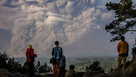"""<strong>February 9:</strong> People watch as the Mount Sinabung volcano shoots ash into the air during an eruption in Karo, Indonesia. <a href=""""http://www.cnn.com/2013/11/20/world/gallery/recently-active-volcanos/index.html"""" target=""""_blank"""">See other recently active volcanoes</a>"""