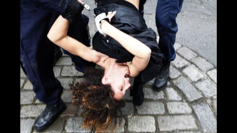 """<strong>February 10:</strong> An activist from the Ukrainian feminist group Femen is arrested by police in Lille, France, after protesting in front of the convoy of Dominique Strauss-Kahn. Strauss-Kahn, the former chief of the International Monetary Fund, was on trial for aggravated pimping charges. <a href=""""http://www.cnn.com/2015/06/12/europe/france-strauss-kahn-verdict/"""" target=""""_blank"""">He was acquitted</a> in June."""