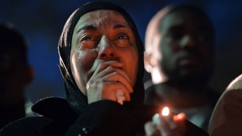 <strong>February 11: </strong>A woman cries during a vigil as she sees photos of the three people who were killed at an apartment near the University of North Carolina at Chapel Hill. Three Muslim students -- Deah Shaddy Barakat, 23; his wife, Yusor Mohammad, 21; and her sister, Razan Mohammad Abu-Salha, 19 -- were found shot to death a day earlier. A 46-year-old suspect, Craig Stephen Hicks, was charged with murder.