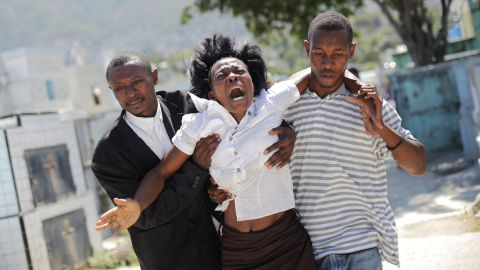 """<strong>February 21:</strong> A woman reacts as she walks to a cemetery to attend the funeral of Carnival stampede victims in Port-au-Prince, Haiti. <a href=""""http://www.cnn.com/2015/02/17/world/haiti-carnival-deaths/"""" target=""""_blank"""">At least 16 people were killed</a> during an accident involving an electrical shock on a float, government officials said. Video from the scene appeared to show a power line striking a man atop a float. Chaos erupted, and revelers ran in all directions. Officials canceled Carnival activities and declared three days of national mourning."""