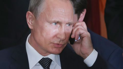 NEW YORK, NY - SEPTEMBER 28:  (AFP OUT) Russian President Vladimir Putin takes a call during a luncheon hosted by United Nations Secretary-General Ban Ki-moon at the 70th annual UN General Assembly at the UN headquarters September 28, 2015 in New York City. U.S. President Barack Obama will hold a bilateral meeting with Putin later in the day.  (Photo by Chip Somodevilla/Getty Images)