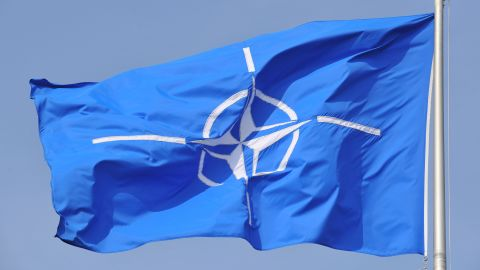 NATO flag flying at NATO Headquarters Brussels.
