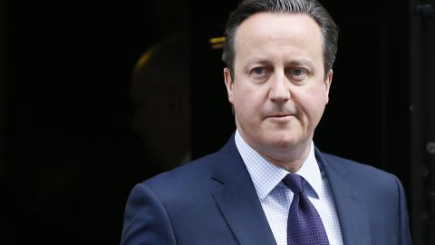 """Britain's Prime Minister David Cameron leaves 10 Downing Street to attend Parliament in London, Thursday, Nov. 26, 2015. Prime Minister David Cameron says Britain must join airstrikes in Syria to deny the Islamic State group a """"safe haven"""" from which to plot mass-casualty attacks around the world."""