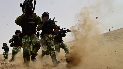 KASHGAR, CHINA - AUGUST 17: (CHINA OUT) Soldiers of Xinjiang Armed Police Frontier Corps get drill in gobi desert of Yecheng County on August 17, 2015 in Kashgar, Xinjiang Uygur Autonomous Region of China. (Photo by ChinaFotoPress/ChinaFotoPress via Getty Images)