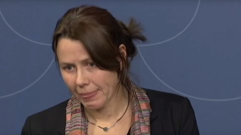 """Swedish Deputy Prime Minister Asa Romson fights tears as she announces Sweden's """"open door"""" policy for asylum is ending."""