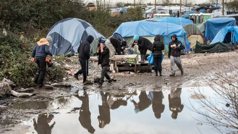 """Migrants and refugees in the migrant camp known as the """"Jungle"""" near the northern French port of Calais where some 4,500 people live."""