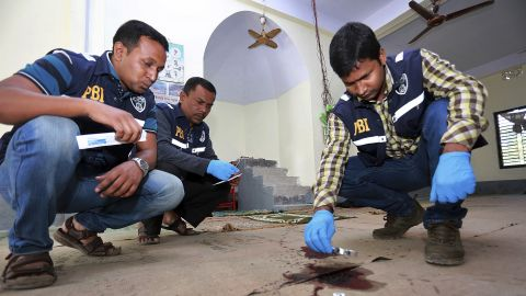 """Investigators check the scene of a mosque attack Friday, November 27, in northern Bangladesh's Bogra district. <a href=""""http://www.cnn.com/2015/11/27/asia/bangladesh-isis-attack-claim/index.html"""" target=""""_blank"""">ISIS has claimed responsibility for the attack</a> that left at least one person dead and three more wounded."""
