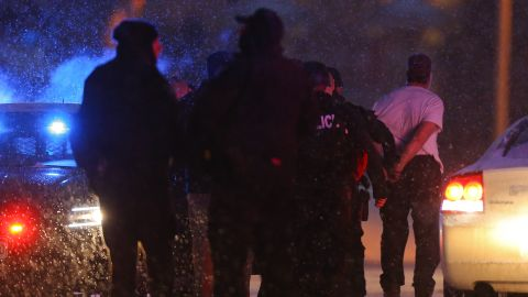 """A suspect is in custody on Friday, November 27, in Colorado Springs, Colorado. Police <a href=""""http://www.cnn.com/2015/11/27/us/colorado-shooting-probe/index.html"""" target=""""_blank"""">were in a shootout</a> with a gunman inside a Planned Parenthood facility, hours after a shooter was first reported in the area."""