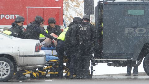 An unidentified victim is transported to an ambulance.