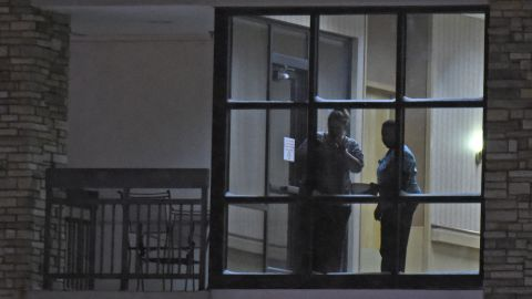 People in the building across from Planned Parenthood in Colorado Springs start to emerge from hiding.