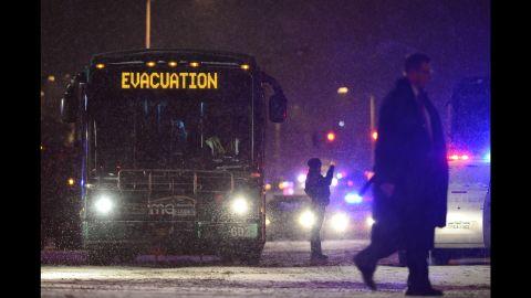 A bus of evacuees make its way towards neighboring hospitals.