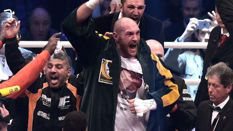 Tyson Fury celebrates after taking the verdict against Wladimir Klitschko to claim the world heavyweight titles.