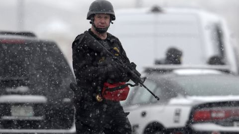 Colorado Springs police officers search the area near the scene.