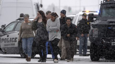 People are helped to safety. It was not immediately clear at the time of the attack whether Planned Parenthood was the target of the shooting.