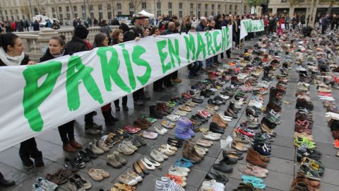 Climate activists organized a silent march in Paris on Sunday to avoid defying a ban on mass protests.
