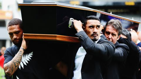 Lomu had suffered from a rare and chronic liver disease since 1995 and died after returning to New Zealand from the Rugby World Cup in England, won by the All Blacks. His coffin was carried into Auckland's Eden Park by Rugby League player Manu Vatuvei (L) and All Blacks player Jerome Kaino, among others.