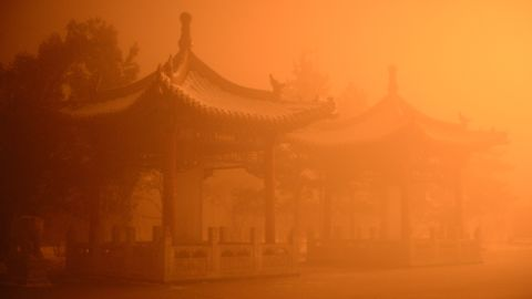 The pollution cast an apocalyptic glow over the pagodas on the streets of Hohhot, Inner Mongolia  on November 29.