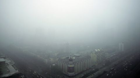 Buildings are shrouded by heavily polluted haze in Beijing on November 30. China's capital and neighboring regions have seen the worst smog of the year this week.