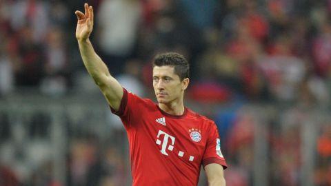 Lewandowski taps in Munich's third in a 4-0 victory against Stuttgart to secure an 11th win in 12 Bundesliga matches.