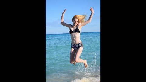 Eleven months after her first stem cell treatment, Sarah jumped for joy on the beach in Cancun. Her wish was to see a beautiful beach before dying; now, she visits to celebrate the success of her treatment.