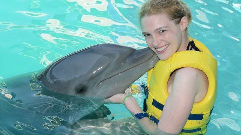 Sarah always wanted to swim with dolphins, but her disease made it impossible for her to even get in the water. Now, she often takes on new adventures.