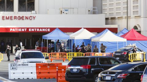 Police stand guard outside of the emergency room at the Loma Linda University Medical Center, where some of the victims were being treated.