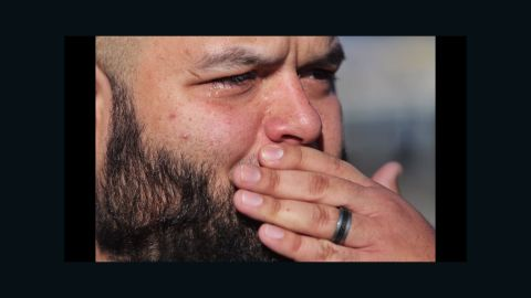 Luis Gutierrez gets emotional as he talks about his wife who works in the facility and saw a gunman, according to Los Angeles Times photographer Marcus Yam.