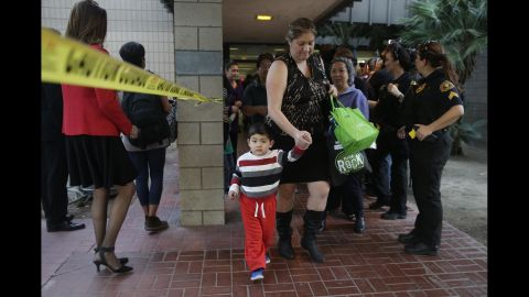 People leave a community center after reuniting with friends and family in the aftermath of the shootings.