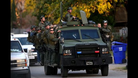 A SWAT team mobilizes during the search.