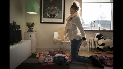 """Camilla gets on her knees to spend time with her twins. It's the only way she can hug them. """"I saw, in one gesture, both struggle and sweetness,"""" photographer Claudia Gori said. """"That picture touches me in a very intimate way."""""""
