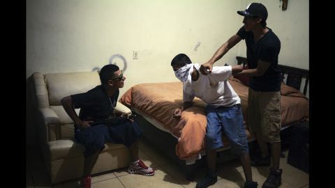 From left, Samuel, Tony and Lams mimic a kidnapping in July 2012.