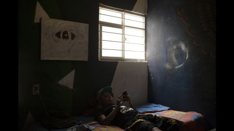 Alejandro rests in his bedroom in June 2013.