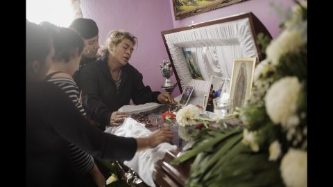"""Doña Tonia mourns over the coffin of her son Manuel in January 2011. Manuel was a member of the street gang """"Los Quimicos,"""" King said, and he was kidnapped and murdered by one of the country's drug cartels."""