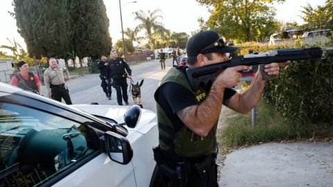 Law enforcement officers search for the suspects of a mass shooting  December 2, 2015 in San Bernardino, California.  A man and a woman suspected of carrying out a deadly shooting at a center for the disabled were killed in a shootout with police, while a third person was detained, police said.        AFP PHOTO / PATRICK T.  FALLON / AFP / Patrick T. Fallon        (Photo credit should read PATRICK T. FALLON/AFP/Getty Images)