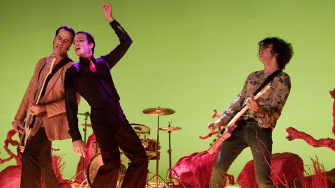 """STP had commercial success throughout the '90s with such albums as """"Purple"""" and """"Tiny Music ... Songs from the Vatican Gift Shop."""" But the relationship between Weiland, center, and the rest of the band -- including brothers Robert DeLeo, left and Dean DeLeo -- was contentious due to Weiland's drug use and erratic behavior. """"When you've got a person like this in your life, it's hard. You've been granted all the things in life you want to do, and when one person pulls the rug out from under you, it's the worst,"""" <a href=""""http://www.rollingstone.com/music/news/scott-weiland-on-the-brink-rolling-stones-1997-feature-20110513#ixzz3tMj1cEwV"""" target=""""_blank"""" target=""""_blank"""">Dean DeLeo told Rolling Stone in 1997</a>. The group broke up in 2003, though it reunited for a time in 2008."""