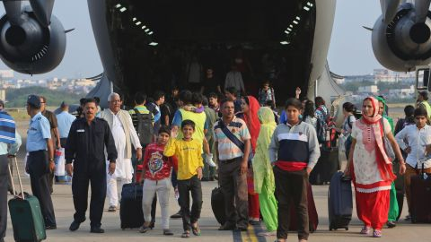 Passengers who were stranded in Chennai due to the floods and rescued in an Indian Air Force C-17 aircraft walk after it landed at the Begumpet Air Force Station, Hyderabad, December 3.