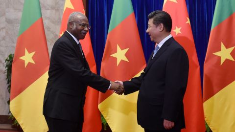Cameroon Prime Minister Philemon Yang shakes hands with Chinese President Xi Jinping before their meeting in Beijing in June, 2015. China invested $3bn in Cameroon in 2011 towards the Memve'ele Dam project in the south of the country.