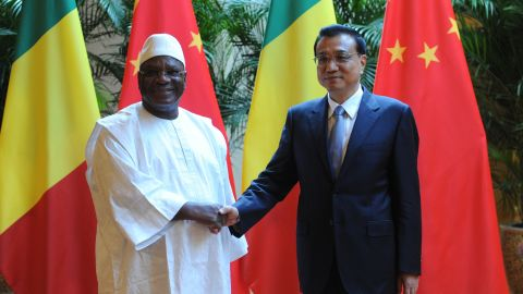 Malian President Ibrahim Boubacar Keita shakes hands with Chinese Premiere Li Keqiang during the World Economic Forum in Tianjin in 2014. More recently, China has pledged to assist security operations in Mali, following an Islamist attack on a hotel in the capital Bamako in November 2015.