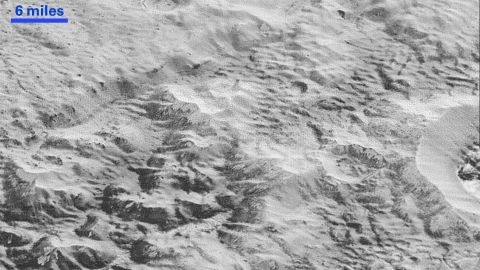 """This image shows how erosion and faulting has sculpted Pluto's icy crust into rugged badlands. The prominent 1.2-mile-high cliff at the top is part of a great canyon system that stretches for hundreds of miles across Pluto's northern hemisphere, NASA says. <a href=""""http://www.nasa.gov/image-feature/pluto-s-badlands"""" target=""""_blank"""" target=""""_blank"""">Learn more at NASA.gov.</a>"""
