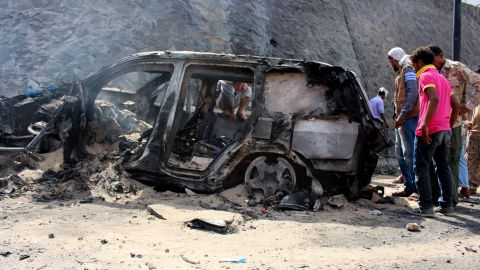 """Yemenis check the scene of a car bomb attack Sunday, December 6, in Aden, Yemen. <a href=""""http://www.cnn.com/2015/12/06/middleeast/yemen-aden-governor-killed/index.html"""">Aden Gov. Jaafar Saad and six bodyguards died in the attack</a>, for which the terror group ISIS claimed responsibility."""