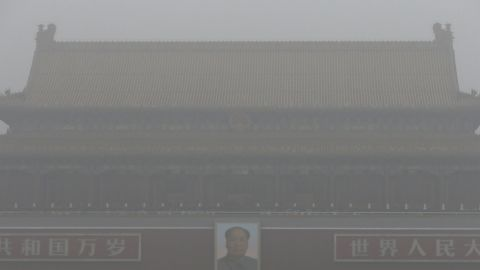 Tiananmen Gate stands shrouded with heavy pollution and fog in Beijing on December 1, 2015. Previously under an orange alert, the second-highest warning level, the Chinese capital enters yet another week choked by toxic smog under the newly issued red alert -- due to be in force until noon of December 10 local time.