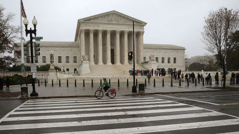 People wait inline to enter the US Supreme Court November 10, 2015 in Washington, DC.